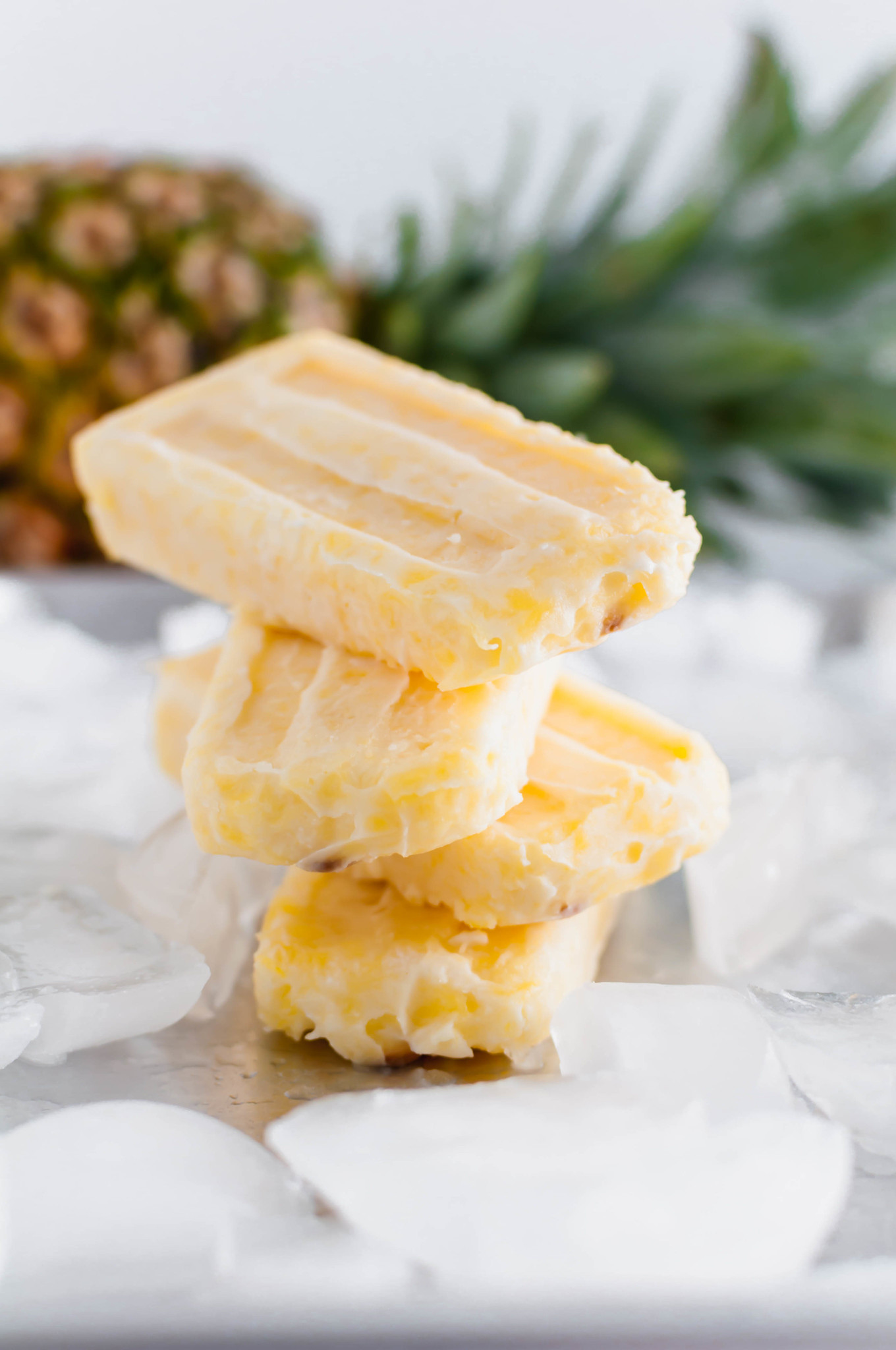 These Pina Colada Popsicles will be the treat of summer. Creamy coconut and sweet pineapple make a simple, delicious dessert that tastes just like the classic drink (without the booze).