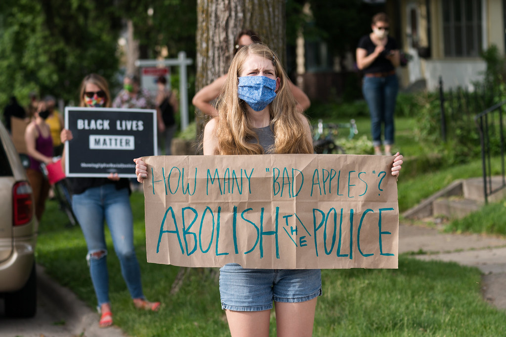 """How Many """"Bad Apples""""? Abolish the Police sign. Protesters along 38th Street in Minneapolis on Tuesday after the death of George Floyd in Minneapolis, Minnesota"""