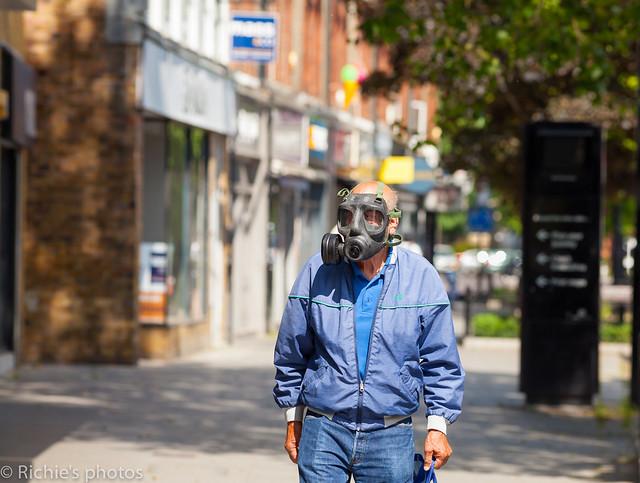 Man wearing gas mask COVID-19