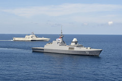 RSS Steadfast (FFS 70) and USS Gabrielle Giffords (LCS 10) sail together in the South China Sea, May 25. (U.S. Navy/MC2 Brenton Poyser)