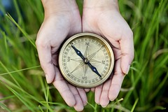 bigstock-hands-holding-a-old-compass-66203638-3-1