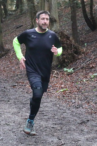 Keith running in woods
