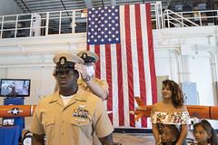 Chief Aviation Ordnanceman Jason Webley has his combination cover placed on by Fleet Activities Okinawa's Command Master Chief Michael Fluent. (U.S. Navy/MC2 Matthew Dickinson)