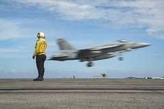 An F/A-18E attached to Strike Fighter Squadron (VFA) 195 practices a touch-and-go maneuver on the recently-deployed aircraft carrier USS Ronald Reagan (CVN 76), May 26. (U.S. Navy/MC3 Jason Tarleton)