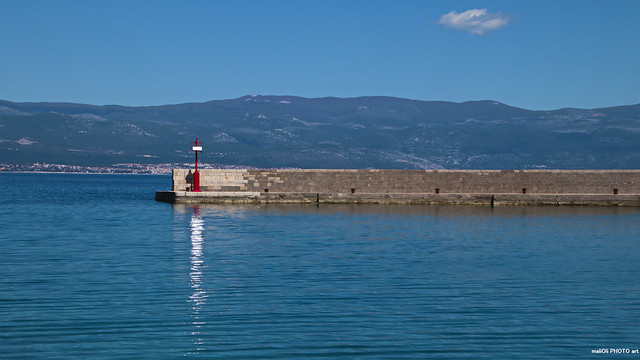 Breakwater on blue Adriatic sea