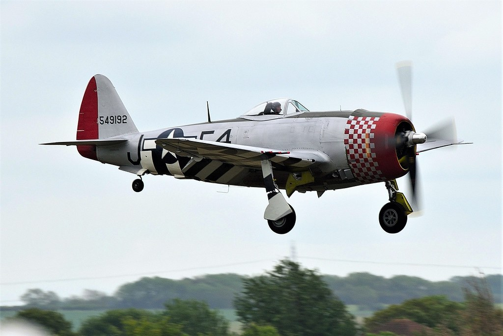Republic P-47D Thunderbolt G-THUN F4-J 549192  Nellie  45-49192 USAAF Seen here in the Gray skies at the Air Festival Airshow