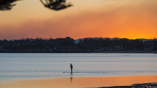 sunset australia brisbane queensland woodypoint water silhouette landscape boat smoke tide paddle olympus shore qld serene travelphotography paddler moretonbay em10 paulleader olympusem10 alone solo serenity solitary isolated