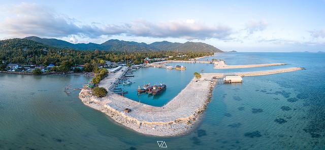 Aerial view of Baan Tai pier or Huatean Pier at Phangan island with clear blue sky, Thailand