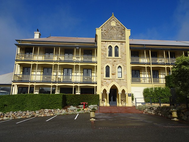 Adelaide Hills. Mount Lofty Ranges. Crafers. Mount Lofty House was built in 1856. Part of it was destroyed in 1983 bushfires. It became the Mecure Hotel in 1986 when this new part in Gothic style was added to it.  .