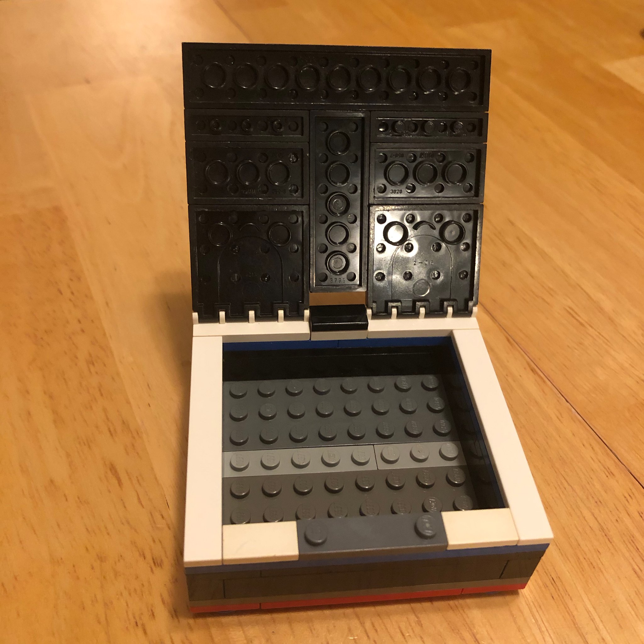 Box with squares on lid open