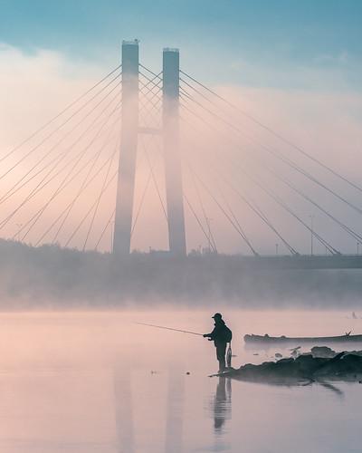 mazovia poland warsaw morning sunrise dawn fog mist bridge people vistula river water pastel landscape nature outdoors