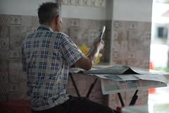 DSC07053- Enjoying his newspaper reading