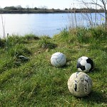 Washed up footballs by the river at Preston