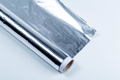 Aluminium foil roll on white background | by wuestenigel