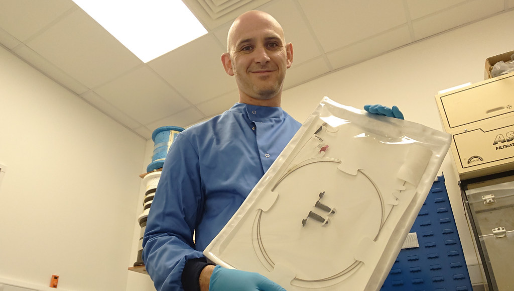 Dr Jim Stone displaying an endoscopic device in its sterile packaging