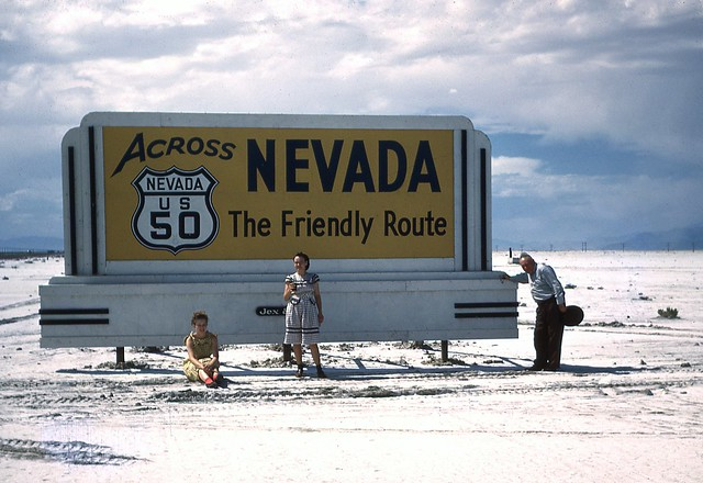 Family posing with Nevada US 50 Highway Sign.  Late 1940's