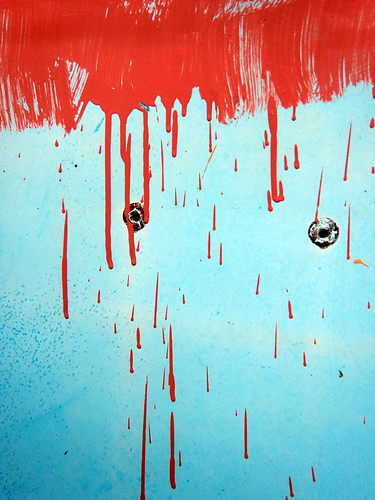 'Red Rain' abstract on a blue Porta-potty on a Victoria beach