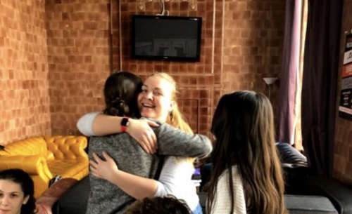 Two Youth Innovation Ltd project participants hugging one another