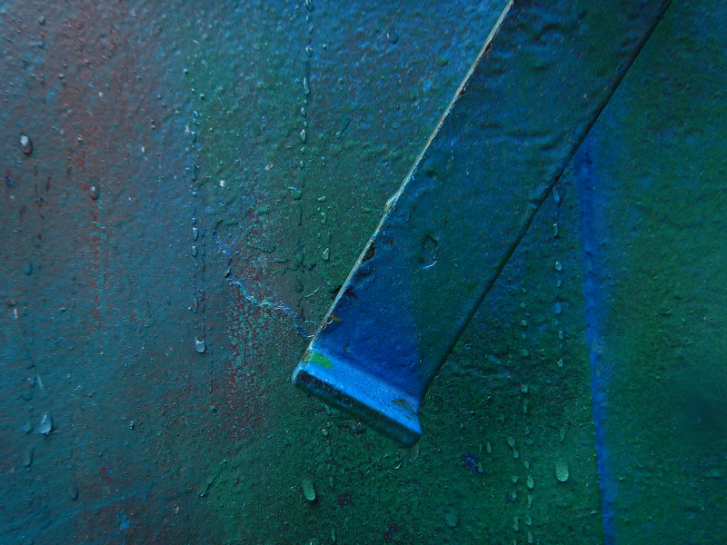 Electric graffiti abstract on a blue dumpster (Vancouver's Chinatown)