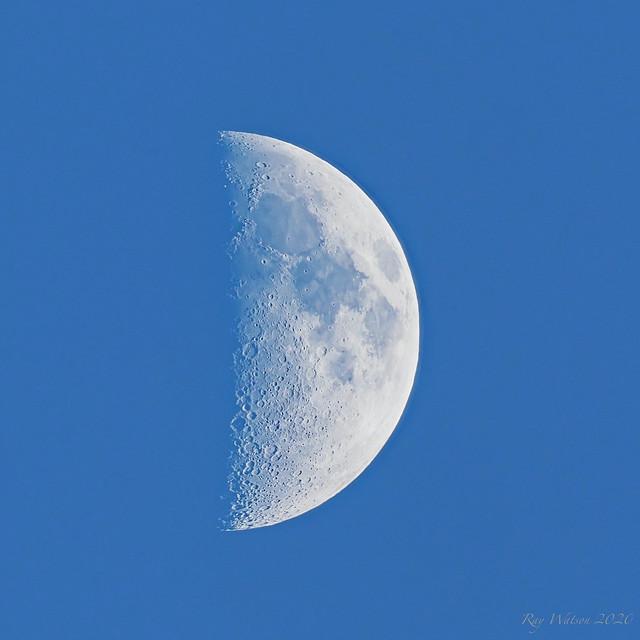 Blue sky half moon