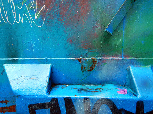 Electric graffiti on a blue dumpster (Vancouver's Chinatown)