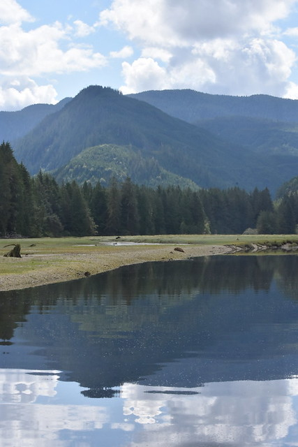 LAYERS OF WATER AND REFLECTION, GRAVEL BEACH,  TREES. HILLS AND  MOUNTAINS...