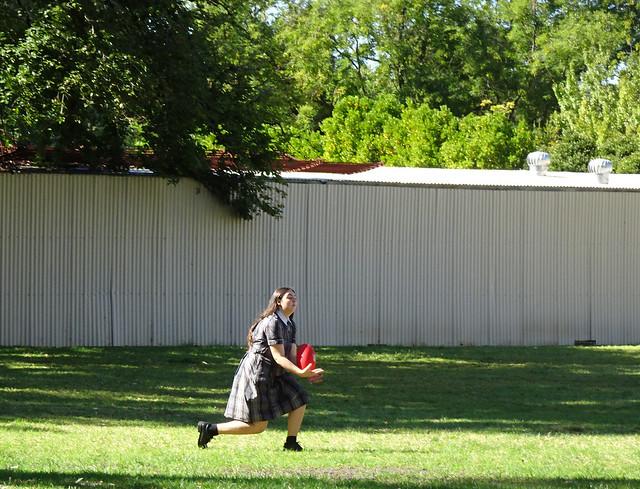 Girl in Uniform Marks Football