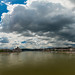 Stormy sky over the city by Behind Budapest