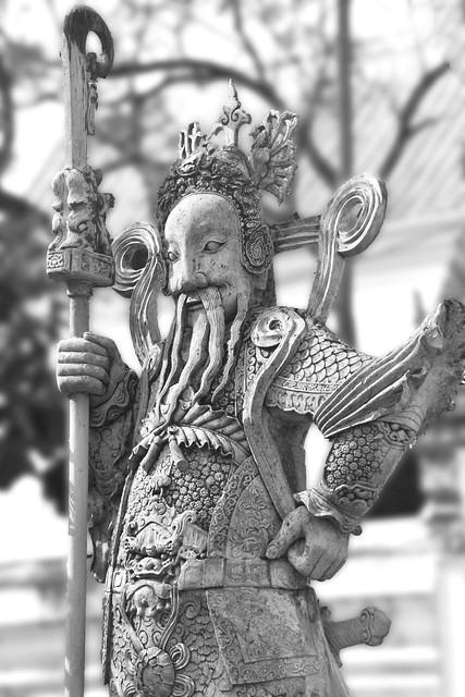 Stoned Carved warrior at Wat Pho, Bangkok, Thailand.