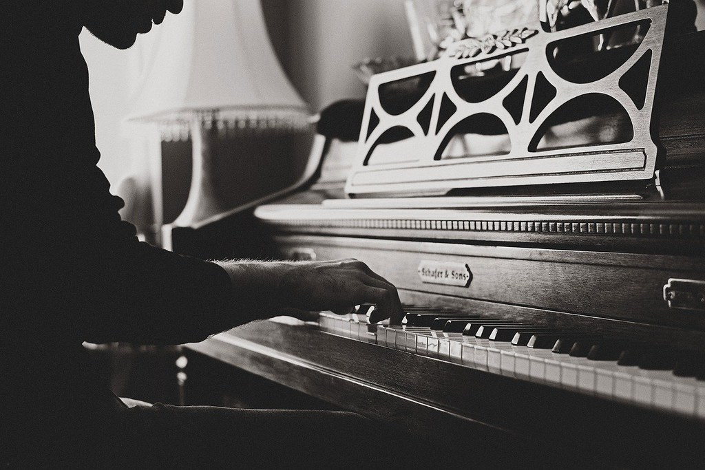 Pianist practicing on upright piano