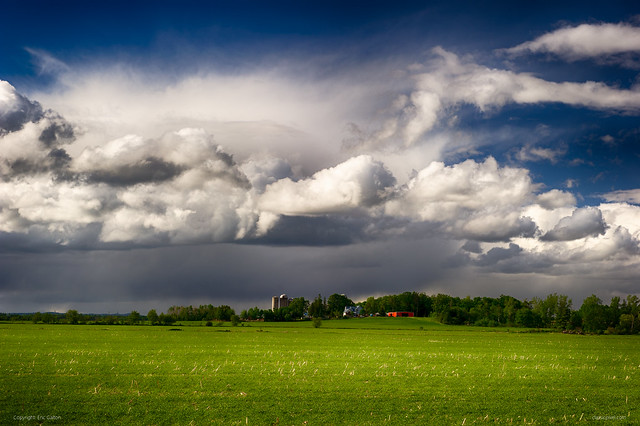 High contrast Canadian farm landscape during heavy rain