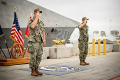 Capt. Matthew McGonigle, left, and Capt. Jack Fay, salute during the Littoral Combat Ship Squadron 1 change of command ceremony. (U.S. Navy/MC2 Alex Corona)