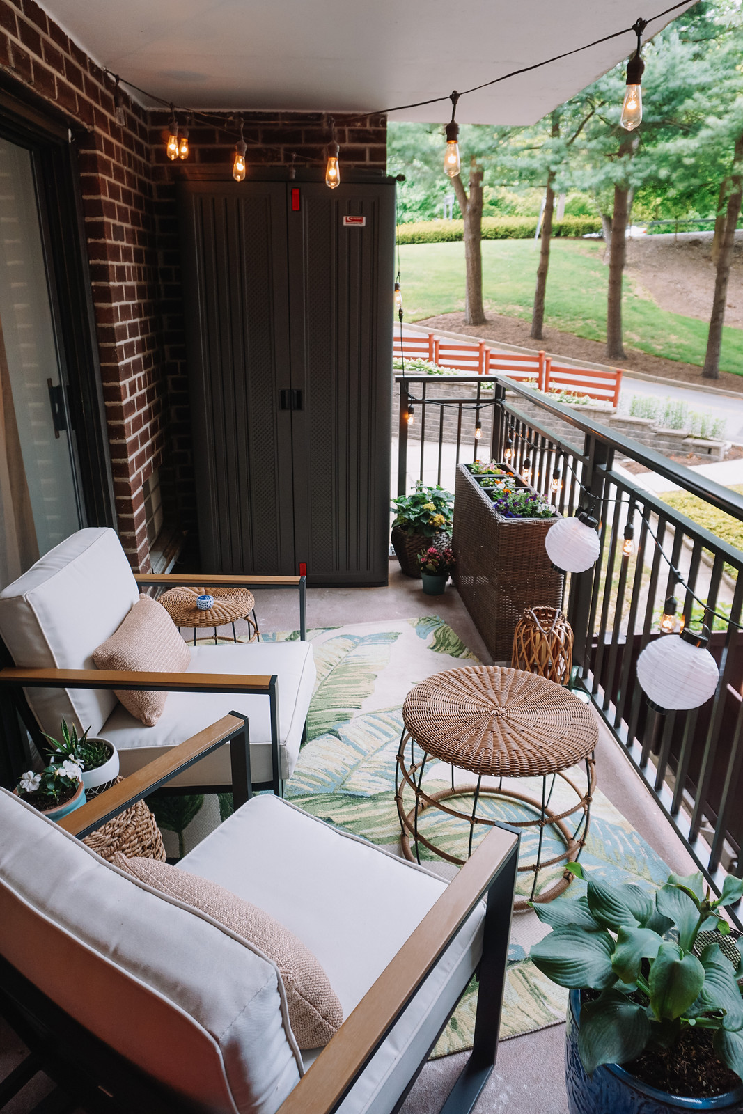 My Apartment Balcony Reveal + More Affordable Outdoor Inspiration | Target Outdoor Furniture | Outdoor Palm Print Rug | Wicker Furniture Inspiration | Outdoor Oasis String Lights | How to Decorate a Small Balcony | Patio Ideas | Deck Inspiration | Outdoor Living Room | Outdoor Decorating Ideas | Terrace | Porch | Patio Renovation | Balcony Remodel