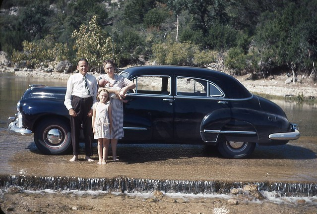 Oklahoma family with Oldsmobile. Late 1940's