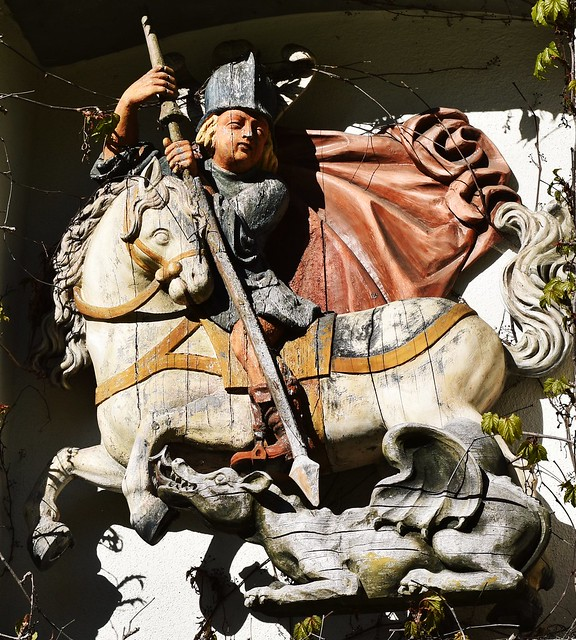 Old carving of St. George fighting the dragon seen above a door at Ratzenried Castle in the village of Ratzenried, Baden-Württemberg