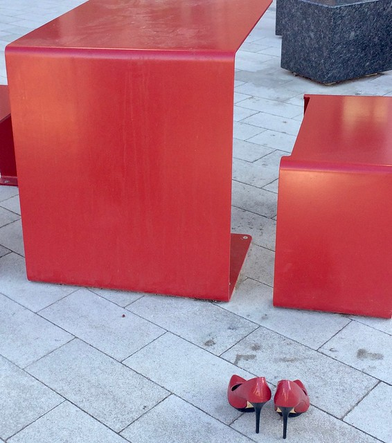 Shoes left in front of new condo tables