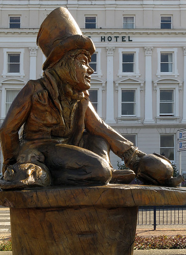 A wood sculpture of Alice in Wonderland's Mad Hatter in Llandudno, Wales
