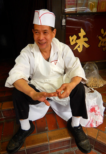 A cook in Vancouver's Chinatown takes a break
