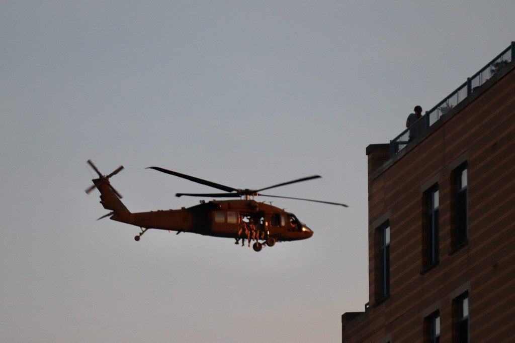 Black Hawk helicopter flies past Logan Circle apartment building
