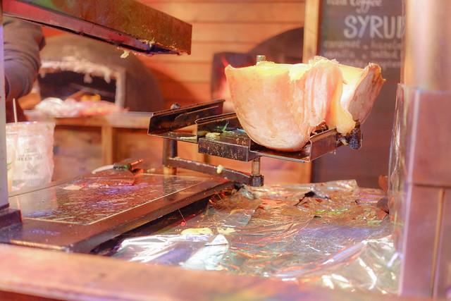 Hot cheese melting at the market