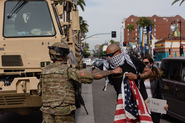 Peaceful Protestor Thank and Elbows National Guard