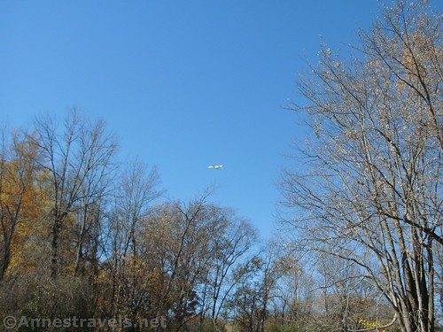 An airplane taking off from the Rochester International Airport over Black Creek, New York
