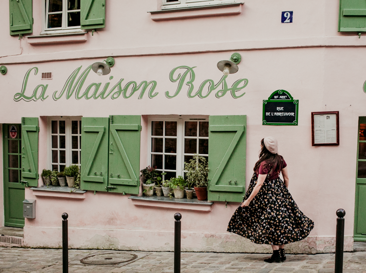 Woman in front of La Maison Rose Paris