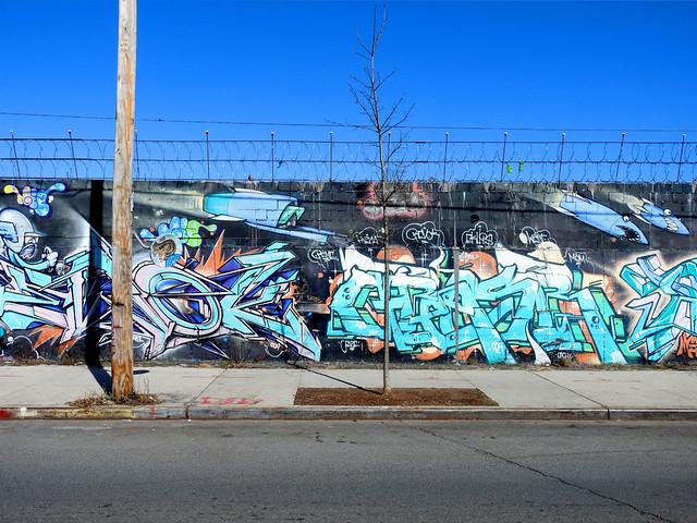graffiti, tree, razor wire, pole