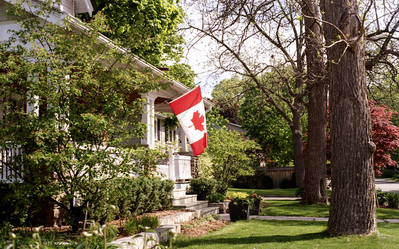 Flying the Maple Leaf On the Front Porch