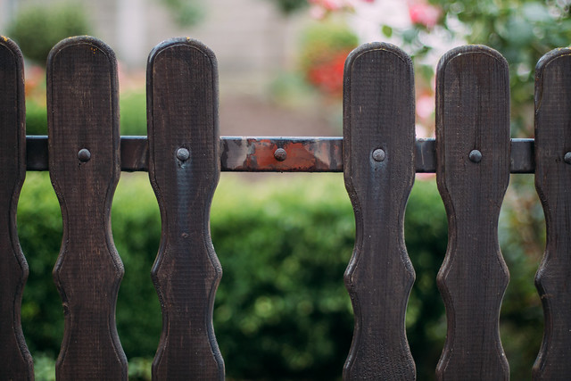 Broken picket on a wooden fence