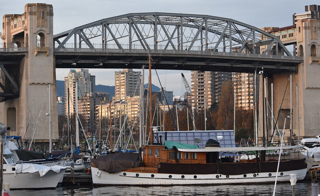 A WONDERFUL OLD CLASSIC BOAT.  FALSE CREEK MARINA,  BURRARD STREET BRIDGE,  VANCOUVER,  BC.
