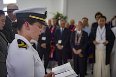 Lt. Emily Rosenzweig reads a Hebrew prayer aboard the USS Arizona Memorial during an interfaith prayer service and floral tribute in December 2016. (U.S. Navy/MC2 Katarzyna Kobiljak)