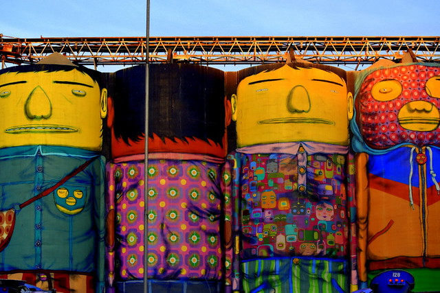 CREATIVE PAINTINGS OF ROUND SILOS WHICH ARE PART OF AN INDUSTRY WHO FOUND ITSELF IN A NEW  FASHIONABLE NEIGHBOURHOOD AND CAME UP WITH VERY CREATIVE PAINTINGS ON THEIR SILOS.   (OCEAN CEMENT)