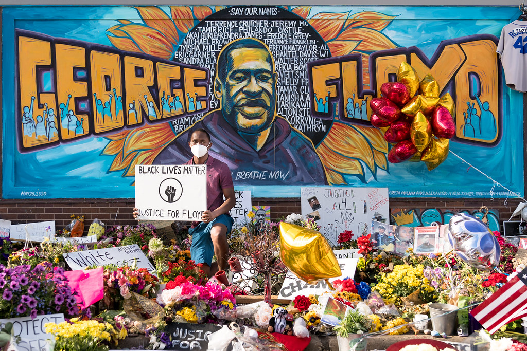 The George Floyd mural outside Cup Foods at Chicago Ave and E 38th St in Minneapolis, Minnesota on Thursday evening following a memorial service. The mural has become a popular spot to visit and to have a photo taken in front of it.